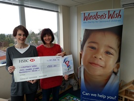 Claire Ward-Dutton presents a cheque to Winston's Wish